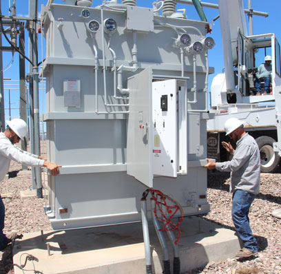 AzGT linemen install a new transformer at the Greenlee substation